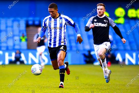 Liam Palmer of Sheffield Wednesday and Jack Marriott of Derby County chase down the ball