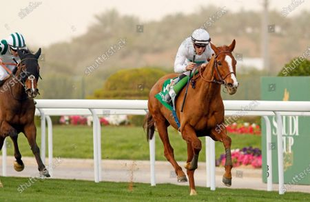 Stock Picture of CALL THE WIND (Olivier Peslier) wins The Longines Turf Handicap King Abdulaziz Racecourse, Riyadh, Saudi Arabia