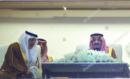 Saudi King Salman, and Prince Khaled Al-Faisal, Governor of Makkah province, watch the final race of the $20 million, the Saudi Cup, at King Abdul Aziz race track in Riyadh, Saudi Arabia, . The race is considered the world's richest horse race which attracted some of the world's best male and female jockeys