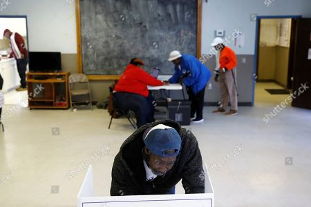 Stock Image of John Singleton fills out his ballot at a primary polling place, in Charleston, S.C