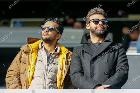 Queens Park Rangers chairman Amit Bhatia (right), with friend (left), during the EFL Sky Bet Championship match between Queens Park Rangers and Birmingham City at the Kiyan Prince Foundation Stadium, London