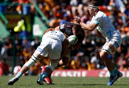 Chris van Zyl of the Stormers (C) is tackled by Tom Robinson of the Blues (L) and Dalton Papalii of the Blues (R) during the Super Rugby match between the Stormers of South Africa and the Blues of New Zealand at Newlands Stadium in Cape Town, South Africa, 29 February 2020.