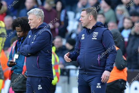 Stock Photo of West Ham Manager David Moyes and West Ham First Team Coach Kevin Nolan during West Ham United vs Southampton, Premier League Football at The London Stadium on 29th February 2020