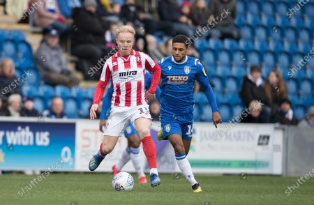 Ryan Broom of Cheltenham Town lays the ball off under pressure from Brandon Comley of Colchester United during Colchester United vs Cheltenham Town, Sky Bet EFL League 2 Football at the JobServe Community Stadium on 29th February 2020