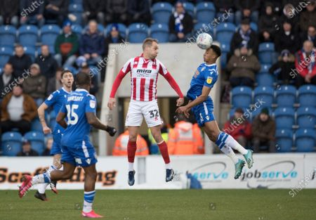 Cohen Bramall of Colchester United heads away from Luke Varney of Cheltenham Town during Colchester United vs Cheltenham Town, Sky Bet EFL League 2 Football at the JobServe Community Stadium on 29th February 2020