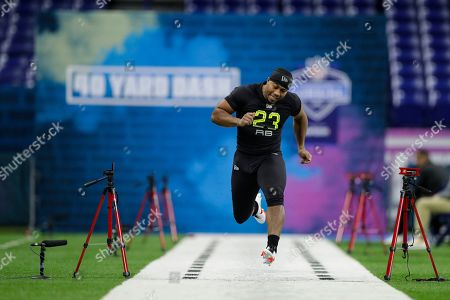 Mississippi running back Scottie Phillips runs the 40-yard dash at the NFL football scouting combine in Indianapolis