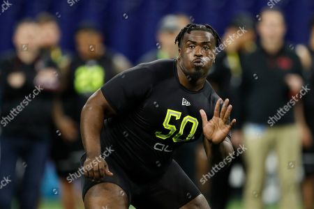 Mississippi State offensive lineman Darryl Williams runs a drill at the NFL football scouting combine in Indianapolis
