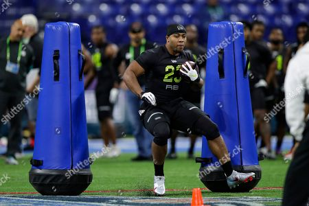 Stock Picture of Mississippi running back Scottie Phillips runs a drill at the NFL football scouting combine in Indianapolis
