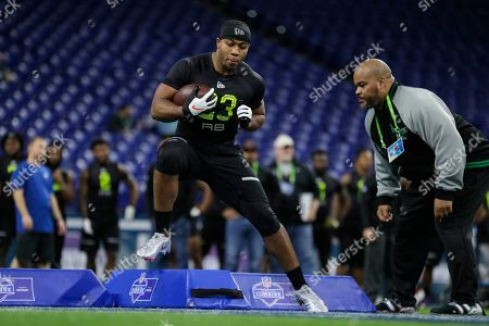 Mississippi running back Scottie Phillips runs a drill at the NFL football scouting combine in Indianapolis