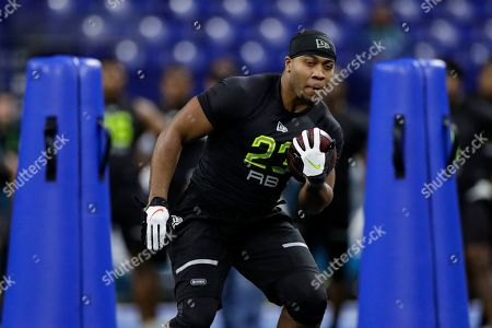 Stock Photo of Mississippi running back Scottie Phillips runs a drill at the NFL football scouting combine in Indianapolis