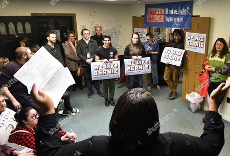 Eliza Booth of Lancaster Stands Up speaks to group members in the organization's offices at its endorsement party for Democratic presidential candidate Bernie Sanders, in Lancaster, Pa. With the 2020 presidential election barreling toward Pennsylvania, grassroots progressive groups that largely rose from deep distress over Donald Trump's 2016 victory are trying to amplify their sway in the battleground state by joining together