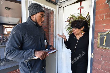 Dom Holmes, a canvasser for Capital Region Stands Up, speaks to a woman at her door as he goes door-to-door asking people to sign a petition for a $15 minimum wage and to come to the organization's meetings, in Harrisburg, Pa. With the 2020 presidential election barreling toward Pennsylvania, grassroots progressive groups that largely rose from deep distress over Donald Trump's 2016 victory are trying to amplify their sway in the battleground state by joining together