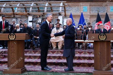 Afghan President Ashraf Ghani (R) shakes hands with NATO Secretary General Jens Stoltenberg (L) during a joint press conference with US Secretary of Defense Esper on the declaration of a peace deal signed between the USA and the Taliban, at the presidential palace in Kabul, Afghanistan, 29 February 2020. The US and the Taliban signed on the day a peace deal in Doha, Qatar after an experimental truce and week-long reduction in violence in the country.