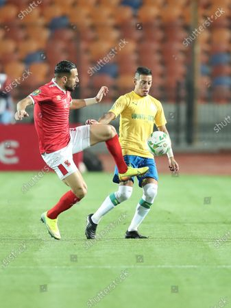 Al Ahly player Ali Maaloul (L) in action against Mamelodi Sundowns player Leandro Affonso (R) during the CAF Champions League quarterfinal first-leg soccer match between Al Ahly and Mamelodi Sundowns at Cairo Stadium in Cairo, Egypt, 29 February 2020.