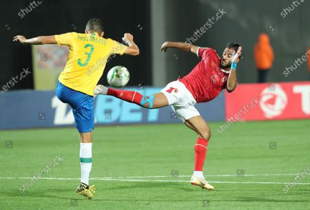Al Ahly player Marwan Mohsen (R) in action against Mamelodi Sundowns player Ricardo Nascimento (L) during the CAF Champions League quarterfinal first-leg soccer match between Al Ahly and Mamelodi Sundowns at Cairo Stadium in Cairo, Egypt, 29 February 2020.