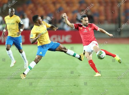 Al Ahly player Ali Maaloul (R) in action against Mamelodi Sundowns player Lebohang Kgsona (L) during the CAF Champions League quarterfinal first-leg soccer match between Al Ahly and Mamelodi Sundowns at Cairo Stadium in Cairo, Egypt, 29 February 2020.