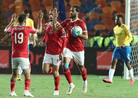 Al-Ahly  player Mohamed Magdy  (L) celebrates with  Marwan Mohsen during the first  leg of CAF champion league  soccer match between Al-Ahly  and Mamelodi Sundown  at Cairo Stadium in Cairo Egypt, 29 February  2020.