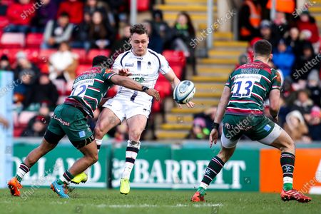 Jamie Shillcock of Worcester Warriors is tackled by Kyle Eastmond of Leicester Tigers