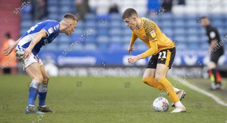 Lewis Collins in action against Oldham Athletic