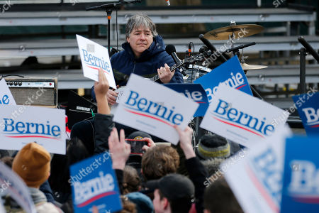 Musician Bela Fleck performs before Democratic presidential candidate Sen. Bernie Sanders, I-Vt., campaigns during a rally on Boston Common, in Boston