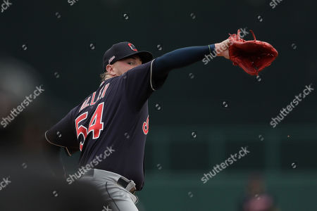 Stock Image of Cleveland Indians starting pitcher Logan Allen works against a Chicago White Sox batter during the second inning of a spring training baseball game, in Glendale, Ariz