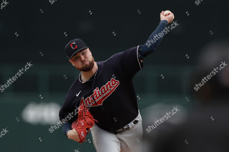 Cleveland Indians starting pitcher Logan Allen works against a Chicago White Sox batter during the second inning of a spring training baseball game, in Glendale, Ariz