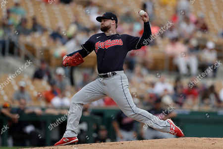Cleveland Indians starting pitcher Logan Allen works against a Chicago White Sox batter during the first inning of a spring training baseball game, in Glendale, Ariz