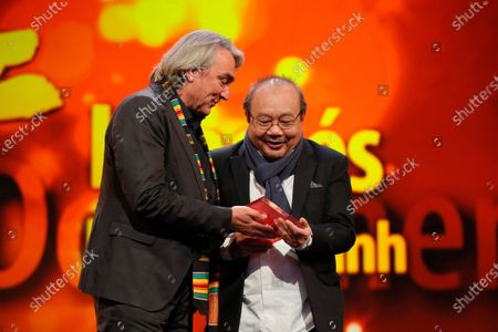 Rithy Panh (R) winner of the Documentary Award for 'Irradies' during the Closing and Awards Ceremony of the 70th annual Berlin International Film Festival (Berlinale), in Berlin, Germany, 29 February 2020. The Berlinale runs from 20 February to 01 March 2020.