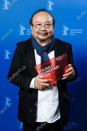 Rithy Panh poses with the Documentary Award for the movie 'Irriadies' during the Closing and Awards Ceremony of the 70th annual Berlin International Film Festival (Berlinale), in Berlin, Germany, 29 February 2020. The Berlinale runs from 20 February to 01 March 2020.
