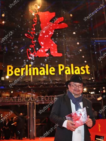 Rithy Panh poses with the Documentary Award for the movie 'Irriadies' as he leave the Berlinale Palace for his press conferencre at the 70th annual Berlin International Film Festival (Berlinale), in Berlin, Germany, 29 February 2020. The Berlinale runs from 20 February to 01 March 2020.