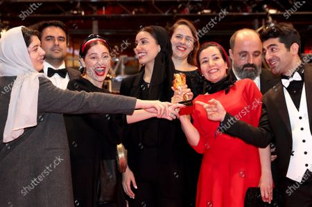 Cast and crew form the movie, winners of the Golden Bear on behalf of director Mohammad Rasoulof for the movie 'Sheytan vojud nadarad' (There Is No Evil), celebrate after Closing and Awards Ceremony of the 70th annual Berlin International Film Festival (Berlinale), in Berlin, Germany, 29 February 2020. The Berlinale runs from 20 February to 01 March 2020.