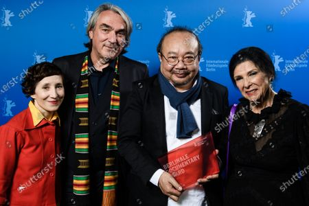 Stock Photo of Rithy Panh (3-L) poses with the Berlinale Documentary Jury, Marie Losier (L), Gerd Kroske (2-L) and Alanis Obomsawin (R) with the Documentary Award for the movie 'Irradiated' during the Closing and Awards Ceremony of the 70th annual Berlin International Film Festival (Berlinale), in Berlin, Germany, 29 February 2020. The Berlinale runs from 20 February to 01 March 2020.