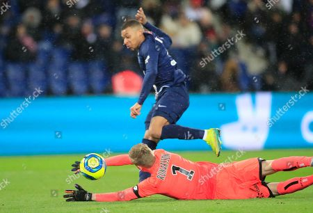 PSG's Kylian Mbappe scores his side's second goal past Dijon's goalkeeper Runar Alex Runarsson during the French League One soccer match between Paris-Saint-Germain and Dijon, at the Parc des Princes stadium in Paris, France