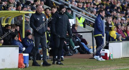 Peterborough United Manager Darren Ferguson on the touchline alongside Burton Albion manager Nigel Clough