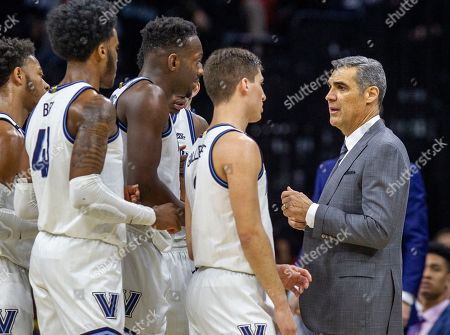 Villanova head coach Jay Wright talks to his players during a break in the action in the first half of an NCAA college basketball game against Providence, in Philadelphia, Pa