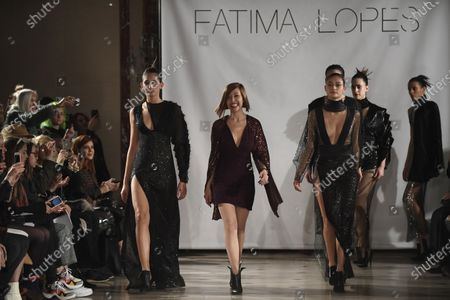 Portuguese fashion designer Fatima Lopes (C) takes to the catwalk to thank the audience after the presentation of her Fall-Winter 2020/21 women's collection during the Paris Fashion Week, in Paris, France, 29 February 2020. The Fall-Winter 2020/21 women's collection runs from 24 February to 03 March 2020.