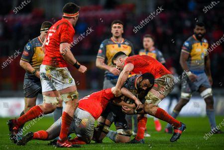 Uzair Cassiem of Scarlets is tackled by Kevin O'Byrne, left, and Jack O'Sullivan of Munster