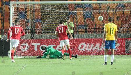 Al-Ahly player Ali Maaloul scoring second goal during the first leg of CAF champion league soccer match between Al-Ahly and Mamelodi Sundown at Cairo Stadium in Cairo Egypt, 29 February 2020.