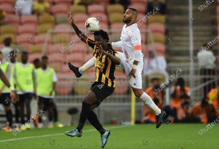 Al-Shabab's Mohamed Salem (R) in action against AL- Ittihad's Wilfried Bony (L) during the Saudi Professional League soccer match between AL- Ittihad and Al-Shabab at King Abdullah Sport City Stadium, Jeddah, Saudi Arabia, 29 February 2020.