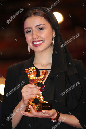 Actress Baran Rasoulof, holds The Golden Bear for Best Film in place of director Mohammad Rasoulof, who did not attend, for the film 'Sheytan vojud nadarad' (There Is No Evil) after the award ceremony at the 70th International Berlinale Film Festival in Berlin, Germany