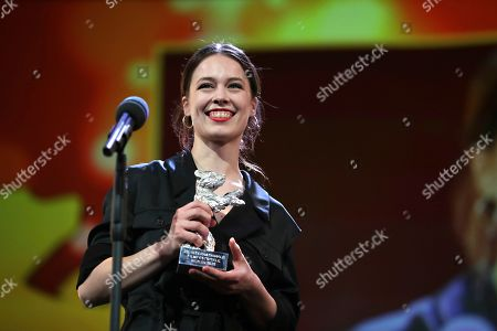 Actress Paula Beer holds The Silver Bear for Best Actress for the film 'Undine' during the award ceremony at the 70th International Berlinale Film Festival in Berlin, Germany