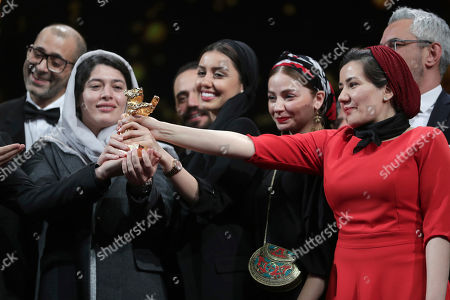 Cast and crew of the film 'Sheytan vojud nadarad' (There Is No Evil), hold The Golden Bear for Best Film in place of director Mohammad Rasoulof, who did not attend, during the award ceremony at the 70th International Berlinale Film Festival in Berlin, Germany
