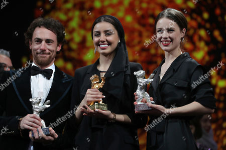 Elio Germano, Baran Rasoulof, Paula Beer. Actors Elio Germano, from left, holds his Silver Bear Best actor award, Baran Rasoulof holds The Golden Bear for Best Film award and Paula Beer holds The Silver Bear for Best Actress award during the award ceremony at the 70th International Berlinale Film Festival in Berlin, Germany