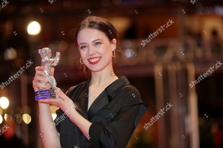 Actress Paula Beer holds The Silver Bear for Best Actress for the film 'Undine' after the award ceremony at the 70th International Berlinale Film Festival in Berlin, Germany