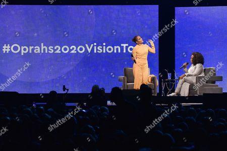 "Jennifer Lopez, Oprah Winfrey. Jennifer Lopez, left, and Oprah Winfrey participate in ""Oprah's 2020 Vision"" tour at the Forum, in Inglewood, Calif"