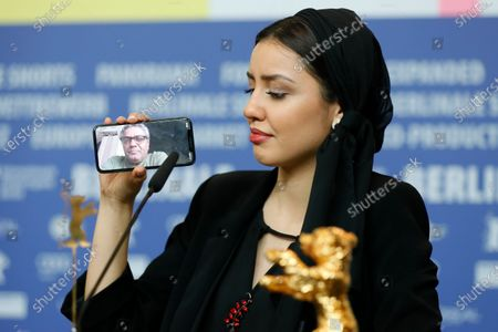 Actress Baran Rasoulof, winner of the Golden Bear on behalf of director Mohammad Rasoulof (on the phone) for the movie 'Sheytan vojud nadarad' (There Is No Evil) attends the Winners' Press Conference after the Closing and Awards Ceremony of the 70th annual Berlin International Film Festival (Berlinale), in Berlin, Germany, 29 February 2020. The Berlinale runs from 20 February to 01 March 2020.