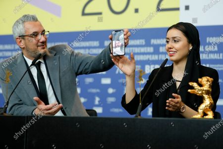 Producer Farzad Pak (L) and actress Baran Rasoulof, winners of the Golden Bear on behalf of director Mohammad Rasoulof for the movie 'Sheytan vojud nadarad' (There Is No Evil) attends the Winners' Press Conference after the Closing and Awards Ceremony of the 70th annual Berlin International Film Festival (Berlinale), in Berlin, Germany, 29 February 2020. The Berlinale runs from 20 February to 01 March 2020.