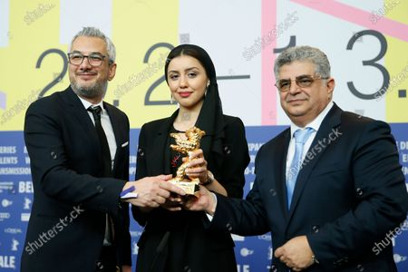 Stock Picture of Actress Baran Rasoulof (C), Producer Kaveh Farnam (R), and producer Farzad Pak winners of the Golden Bear on behalf of director Mohammad Rasoulof for the movie 'Sheytan vojud nadarad' (There Is No Evil) attend the Winners' Press Conference after the Closing and Awards Ceremony of the 70th annual Berlin International Film Festival (Berlinale), in Berlin, Germany, 29 February 2020. The Berlinale runs from 20 February to 01 March 2020.