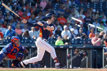 Houston Astros' Taylor Jones watches his sacrifice fly to score teammate Aledmys Diaz during the fourth inning of a spring training baseball game, in West Palm Beach, Fla