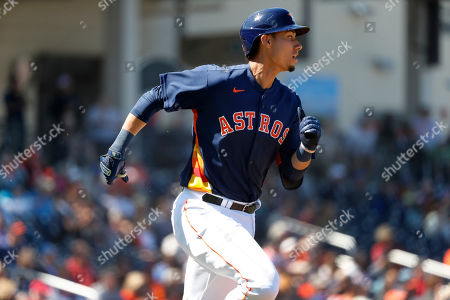 Houston Astros' Taylor Jones runs for a triple during the second inning of a spring training baseball game against the New York Mets, in West Palm Beach, Fla